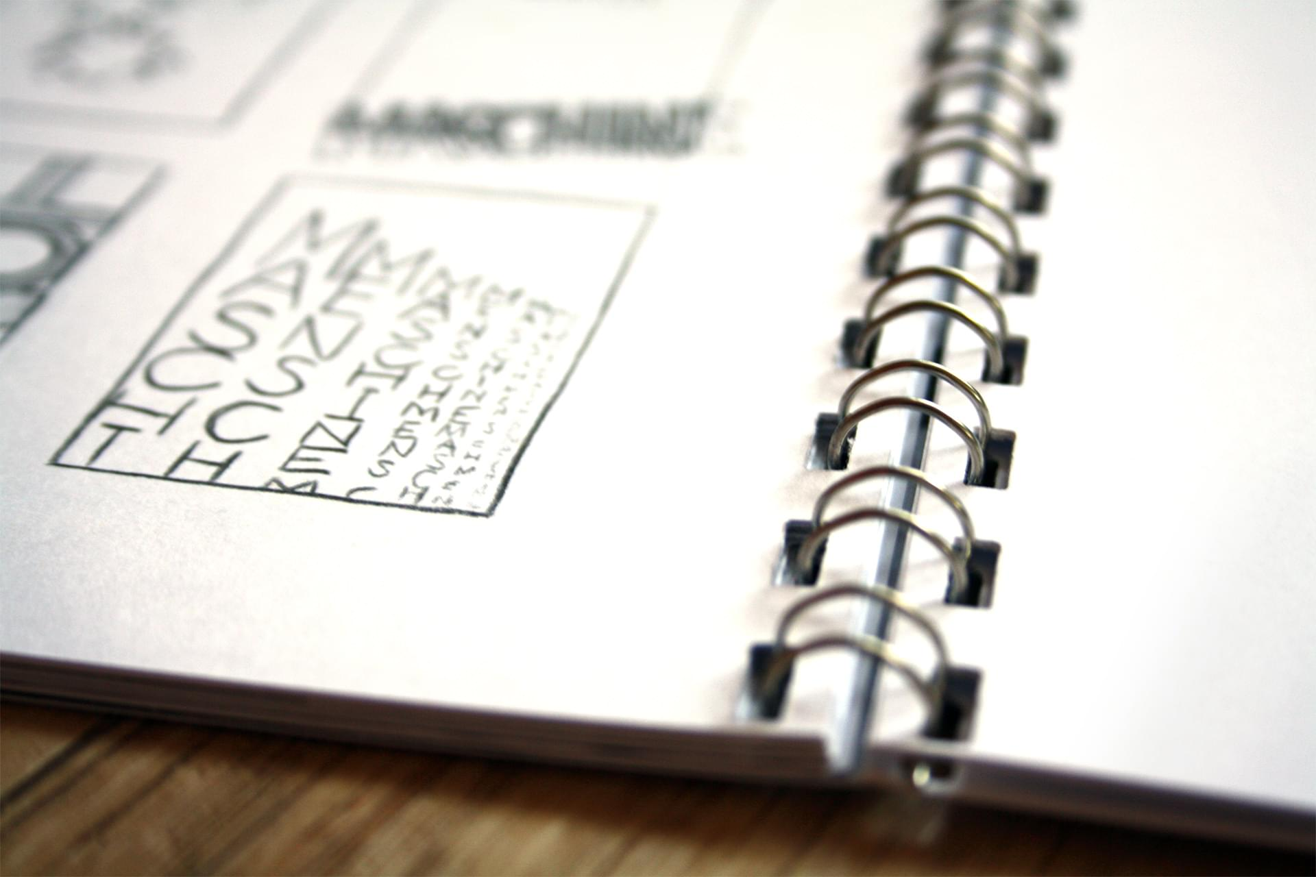 A close-up of the booklet, with the spiral binding clearly visible.